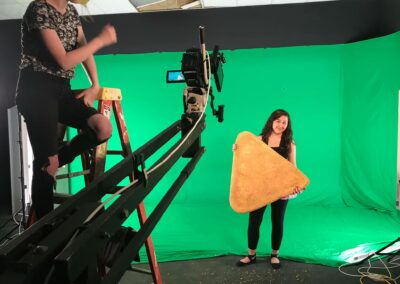 Angel holds a giant Dorito for a commercial spot.